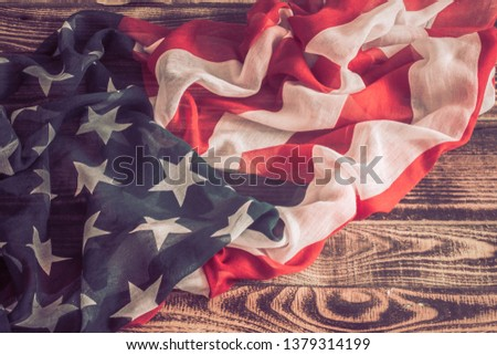 National Patriotic symbols. American flag on an old wooden background.The concept of patriotism and celebration #1379314199