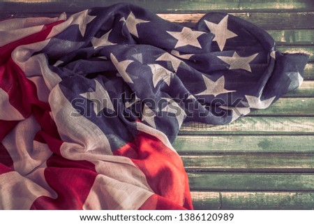 National Patriotic symbols. American flag on an old wooden background.The concept of patriotism and celebration #1386120989