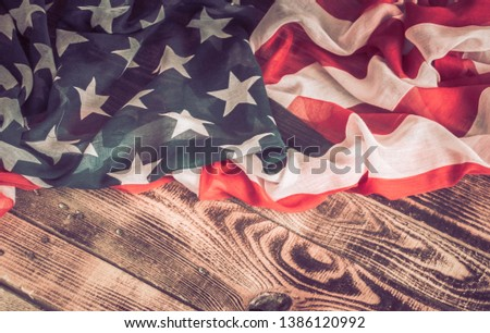National Patriotic symbols. American flag on an old wooden background.The concept of patriotism and celebration #1386120992