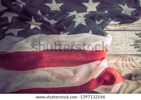 National Patriotic symbols. American flag on an old wooden background.The concept of patriotism and celebration #1397132546