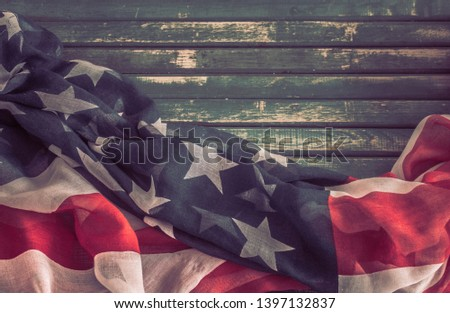 National Patriotic symbols. American flag on an old wooden background.The concept of patriotism and celebration #1397132837