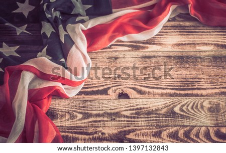National Patriotic symbols. American flag on an old wooden background.The concept of patriotism and celebration #1397132843