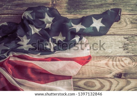 National Patriotic symbols. American flag on an old wooden background.The concept of patriotism and celebration #1397132846