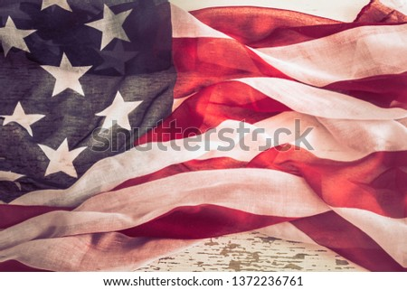 National Patriotic symbols. American flag on old white wooden background.The concept of patriotism and celebration #1372236761