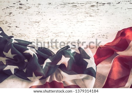 National Patriotic symbols. American flag on old white wooden background.The concept of patriotism and celebration #1379314184