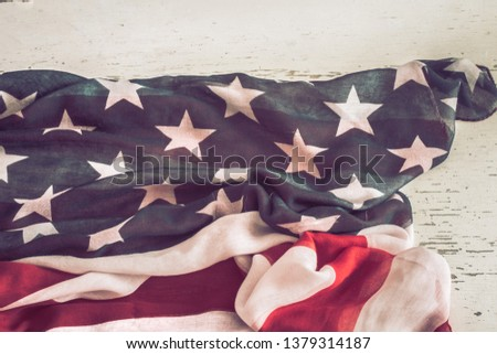 National Patriotic symbols. American flag on old white wooden background.The concept of patriotism and celebration #1379314187