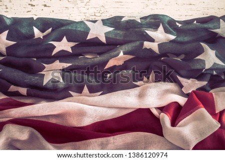 National Patriotic symbols. American flag on old white wooden background.The concept of patriotism and celebration #1386120974