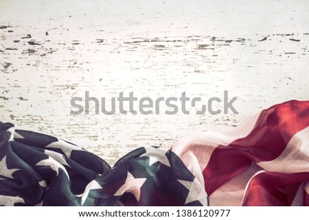 National Patriotic symbols. American flag on old white wooden background.The concept of patriotism and celebration #1386120977