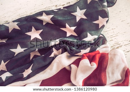 National Patriotic symbols. American flag on old white wooden background.The concept of patriotism and celebration #1386120980