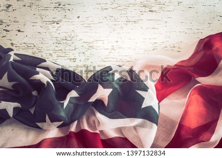 National Patriotic symbols. American flag on old white wooden background.The concept of patriotism and celebration #1397132834