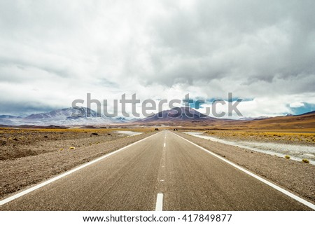 National Route 60 between the mountains of the Andes, in the highlands of Argentina. Background, volcanoes San Francisco and Ojos del Salado #417849877