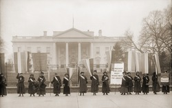 National Women's Party demonstration in front of the White House in 1918. The banner protests Wilson's failure to support women's suffrage.
