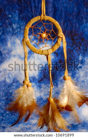native american dream catcher over a blue background