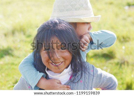 Native american girl holding her little sister in the countryside. #1199159839