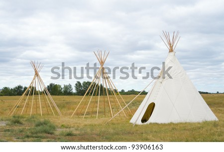 Native American Indian teepees in a field