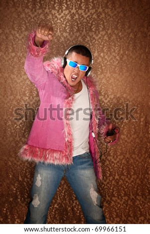 Native American Man in pink jacket enjoys to music from his MP3 player