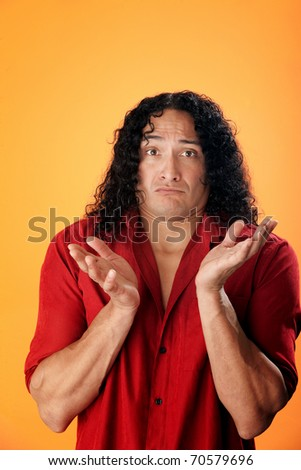 Native American man with open hands of innocence on orange background