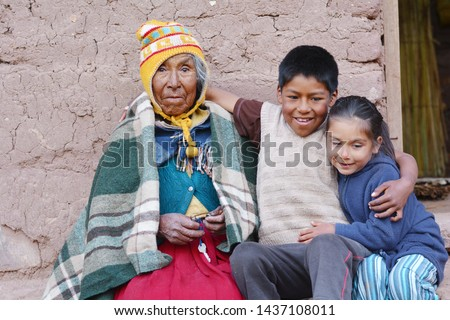 Native american old woman with her grandchildren.