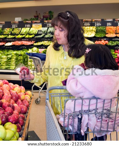 Native American woman shopping in the produce department of a grocery store
