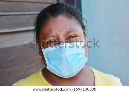 Native american woman wearing mask.