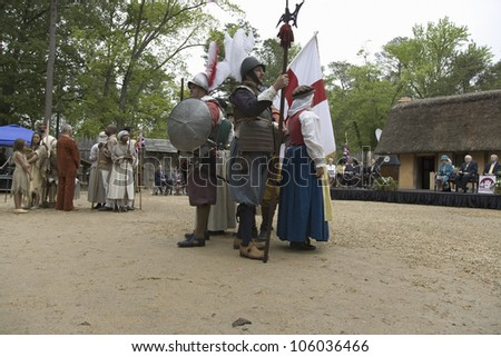 Native Americans, African slave and English settler reenactors posing as part of the 400th anniversary of the Jamestown Colony, Virginia, at the James Fort, Jamestown Settlement, May 4, 2007 - stock photo