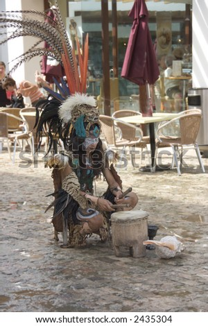 Native maya dancer performing in the street of Caribbean coastline city, Playa del Carmen, Mexico