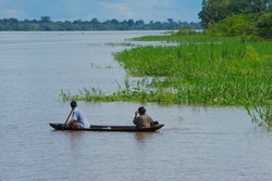 Natives sailing in a small tree trunk canoe on the Amazon River in Loreto-PERU