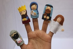 Nativity Finger Puppets, Boy's Hand with Puppets on his Fingers, Felt Material Crib Characters, Selective Focus