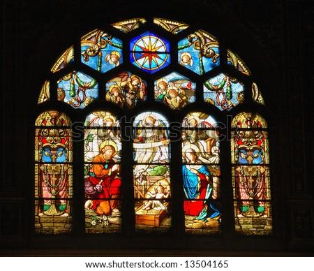 Nativity scene in stained glass church window.