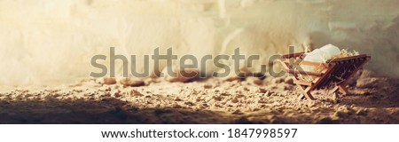 Nativity scene. Jesus is reason for season. Salvation, Messiah, Emmanuel, God with us, hope. Christian Christmas concept. Birth of Jesus Christ. Wooden manger in cave background. Banner, copy space. Photo stock ©