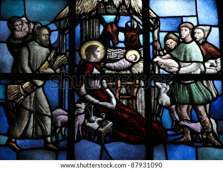 Nativity Scene, stained glass window depicting the adoration of the child Christ by the shepherds in Bethlehem.