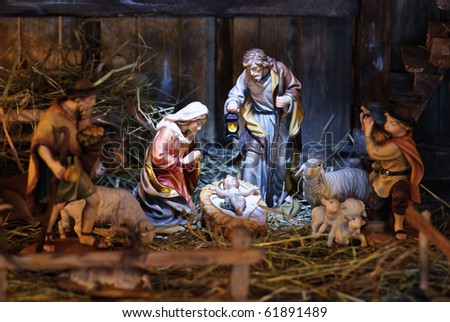 nativity scene with hand-colored figures made out of wood