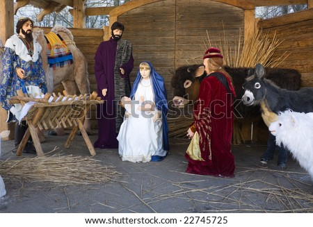 ... with Mary, Joseph, baby Jesus, and animals in a stable - stock photo