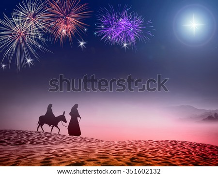 Nativity story scene concept: Silhouette Mary, Joseph and baby Jesus with a donkey on night fireworks background.