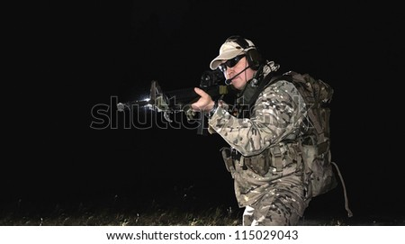 NATO soldier in full gear. - stock photo