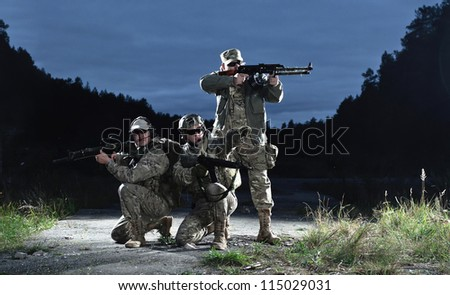 NATO soldiers in full gear. In a defensive posture. Preparing to attack.