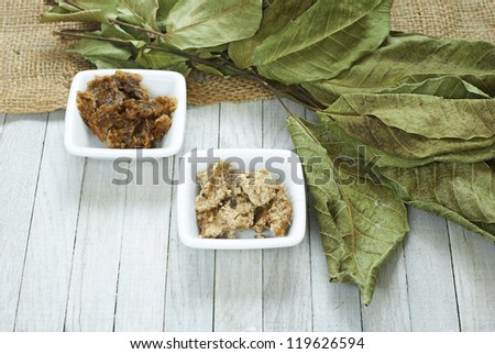 natural african black soap, different estates and ingredients, bright wooden table