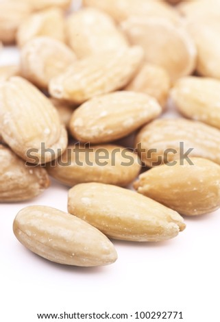 Natural almonds, peeled, over white background