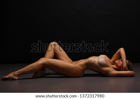 Natural and Perfect well developed body. Woman body after plastic surgery operation.