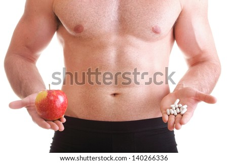 natural apple vitamin or pill drag tablet Man isolated offering pill in one and pills in bottle - in another hand. Copy space boxes with supplements #140266336