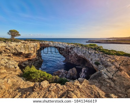 Photo of  Natural arch of Cala Varques on the sunset. Mallorca.