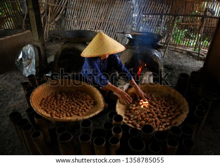 Natural Asian people produces traditional Sweet sugar with handmade, industrial, family factory, noodle producing-image #1358785055