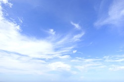 Natural background - blue sky with stratus white clouds over Hat Yai city in May.