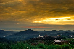 Natural background,high angle that overlooks blurred scenery from fog, rain that flows through,sees Buddha images,temples,mountains,is a viewpoint while traveling in Phetchabun,Khao Kho,Thailand