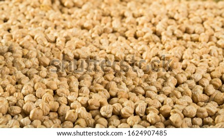 Natural background of raw chickpea. Concept of healthy and nutritious food