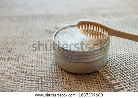 Natural bamboo toothbrushes and kaolin dentifrice or tooth powder made from natural ingredients on rustic background with copy space. Sustainable lifestyle, bathroom essentials in zero waste home Photo stock ©