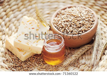 natural bar of soap with honey and wheat - beauty treatment