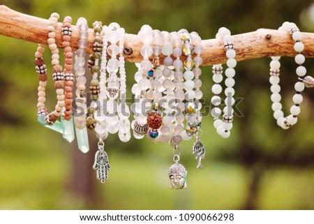 Natural bead bracelets hanging on natural branch #1090066298
