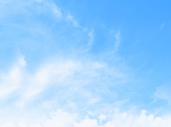 Natural beautiful clear soft blue sky and light thin scatter white puffy clouds with empty space. For product montage, writing wallpaper, website backdrop. Nature banner. Weather forecast background.