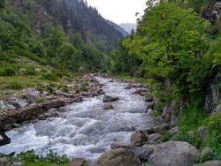 Natural Beauty of Kashmir Valley. Lush green mountains and soothing sound of river flowing through these mountains in the mountains of Naranag.